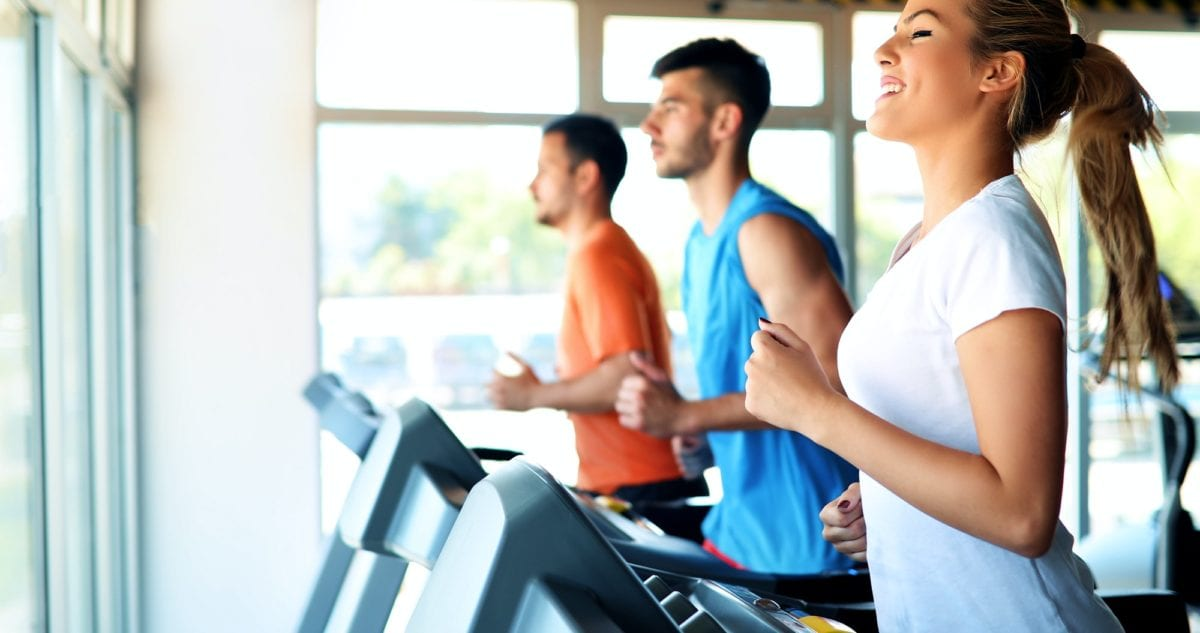 Time-saving hacks for lunchtime workouts. Picture of people running on treadmill in gym