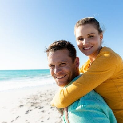 Bariatric surgery improves testosterone and sex drive in men. Couple having fun at the beach