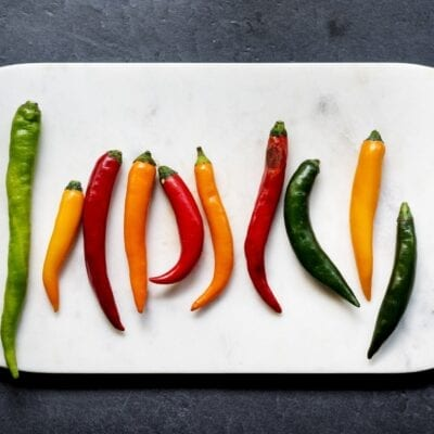 Aerial view of cayenne chili peppers on cutboard
