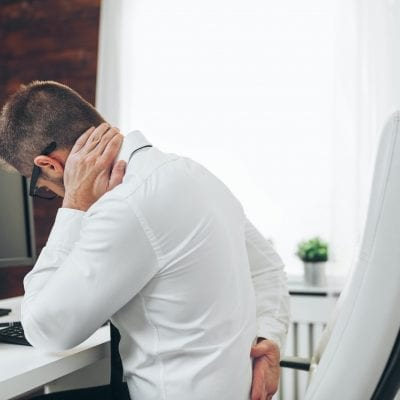 Office worker with pain from sitting at desk all day