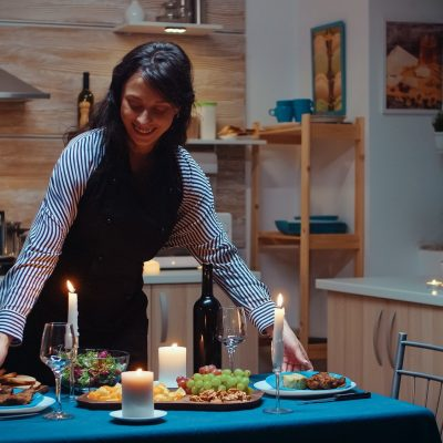 Woman preparing romantic dinner