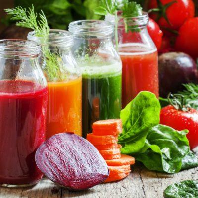 Four kind of vegetable juices: red, burgundy, orange, green