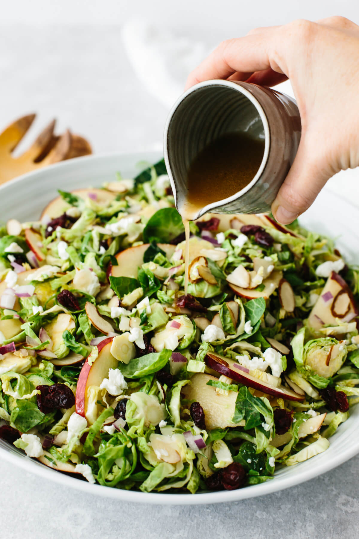 A bowl of a shaved Brussels sprouts salad