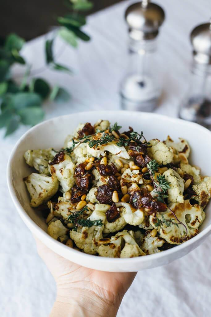 Za'atar roasted cauliflower with dates, pine nuts and thyme.  www.downshiftology.com