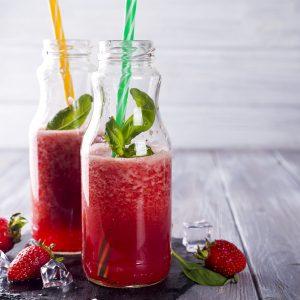 Strawberry smoothie, Strawberry Slush on Wooden Background, Summer Drink, Fresh Beverage